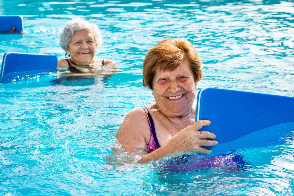 Close,up,portrait,of,two,senior,women,doing,aqua,gym | Hurá na Výlet
